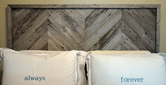 DIY headboard with chevron stripe patterns in the wood.