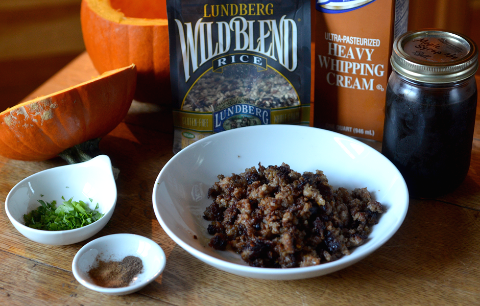 Slow Cooker Sausage Stuffed Pumpkin: brown 1 lb. of ground pork sausage and drain. In a saucepan bring 1 cup of water and 1 cup of wild rice to a boil. Boil for two minutes. Add remaining ingredients and stir to combine.