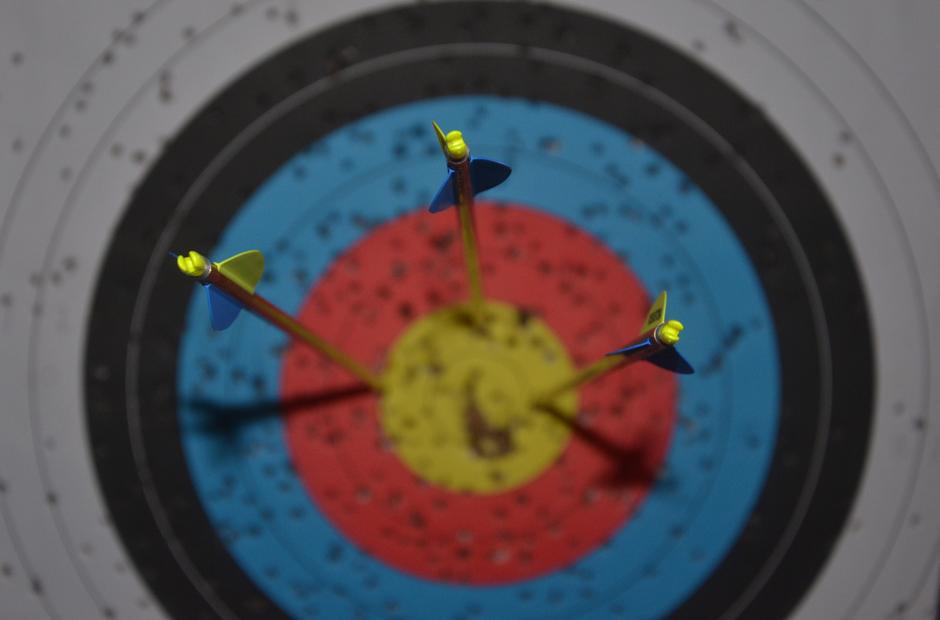 An indoor archery range in a bank barn.