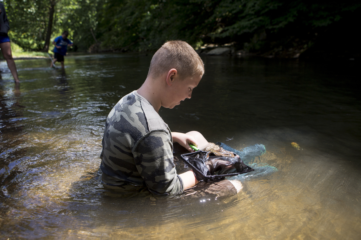 Holding a hellbender for release