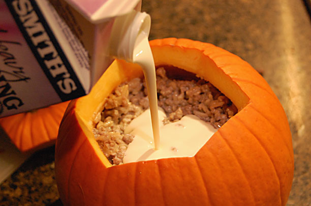 Stuffed Pumpkin Bake - ground beef or sausage, rice and heavy cream combine with herbs and spices for a yummy fall meal. And best of all, serve it in the baked pumpkin!