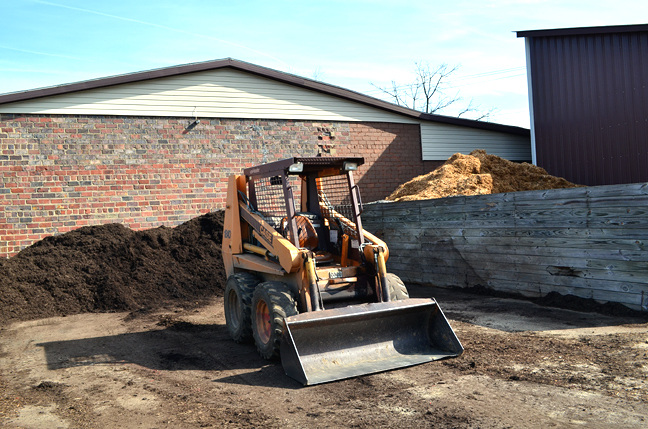 skid steer and mulch