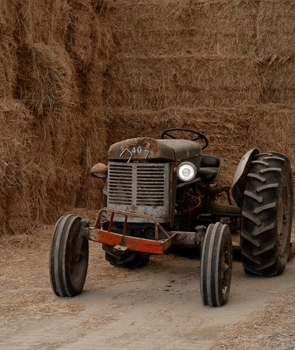 Farm tractor in hay barn