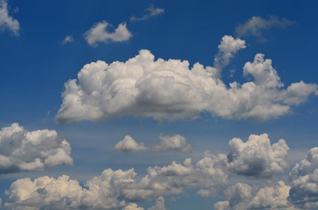 Puffy white clouds in a blue sky.