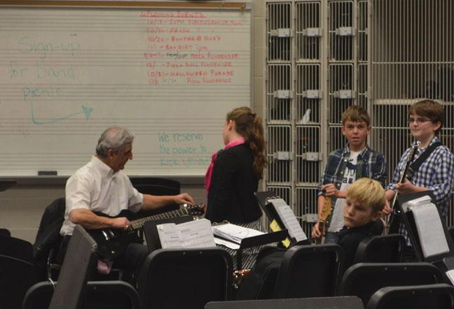 tuning guitar before recital