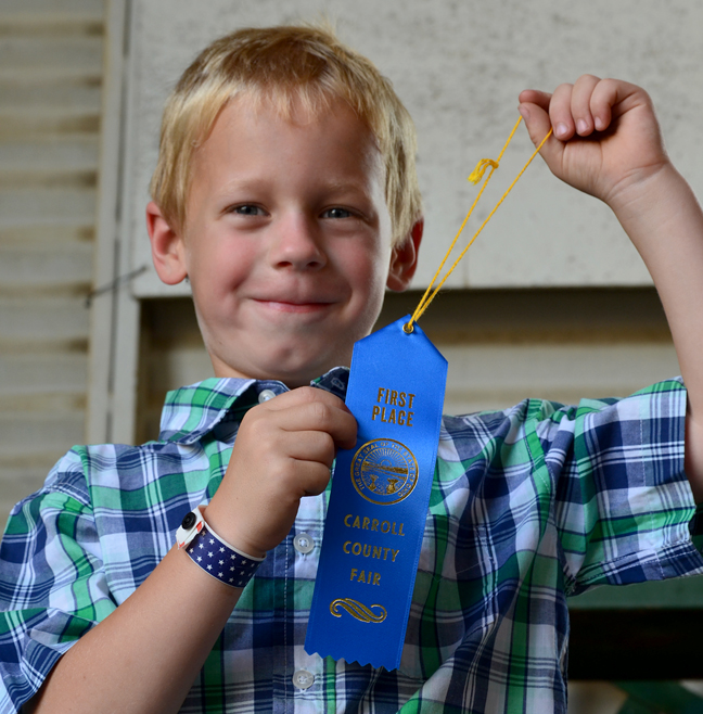 Boy with his blue ribbon
