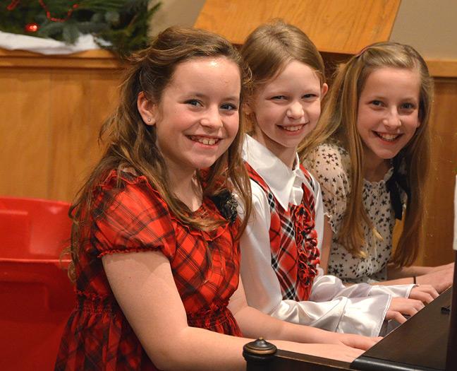 Three girls at piano