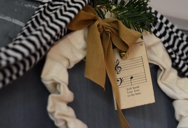 Homespun wreath with tan bow and greenery