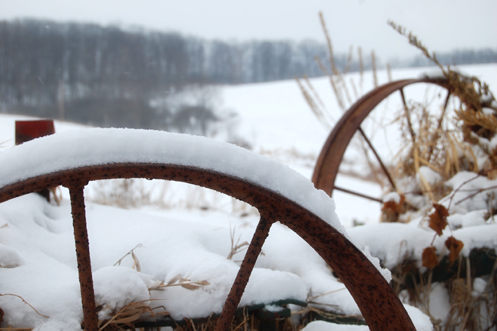 Snow-covered wagon wheel