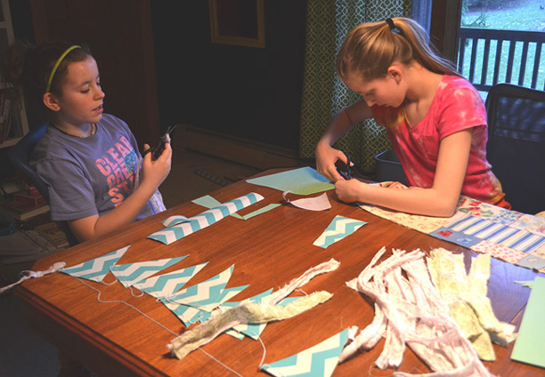 Making bunting with chevron striped contact paper and fabric strips