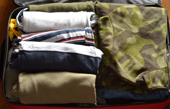 roll clothes in suitcases