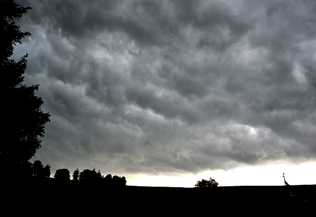 faces in storm clouds
