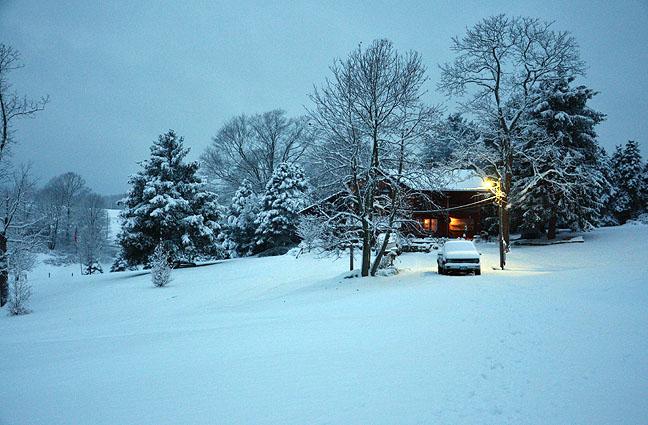Cozy cabin in winter woods