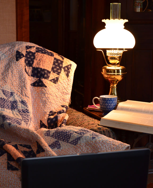 Laptop and chair with quilt