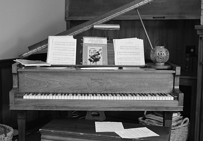 Family piano in black and white