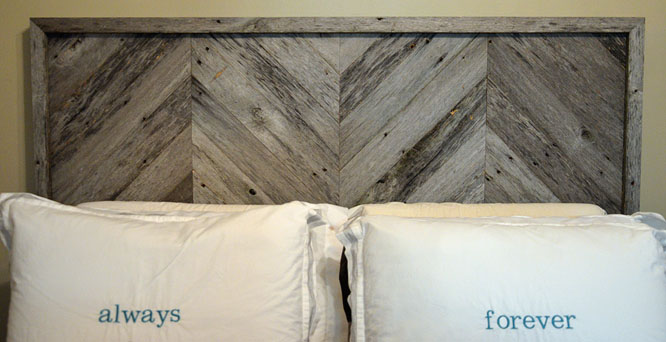 DIY headboard with chevron stripe patterns in the wood.