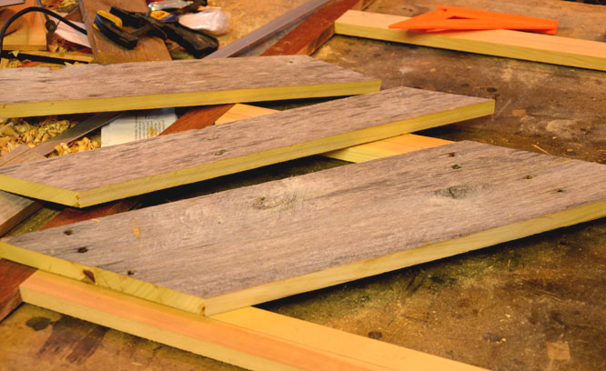 Using a BLACK+DECKER cordless drill to make a chevron stripe head board from old barn wood found on the farm.