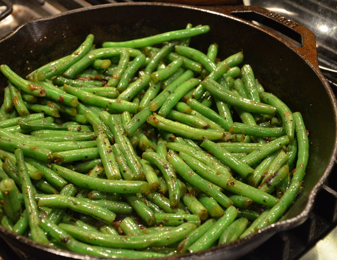 Sauteed green beans in bacon drippings.