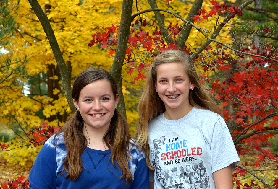 Sisterly smiles in autumn splendor.