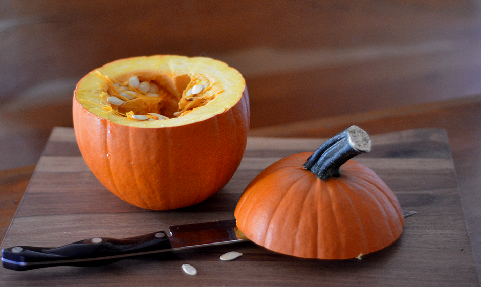 The first step in Slow Cooker Sausage Stuffed Pumpkin is to slice the top off of a pie pumpkin. Place it in your slow cooker first. Be sure to cut the top of the pumpkin about 1-2 inches shorter than the top of the slow cooker.