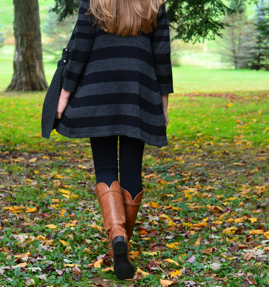 Pair walking boots with a long sweater and black tights for a clean, classic look that's fit for the season.