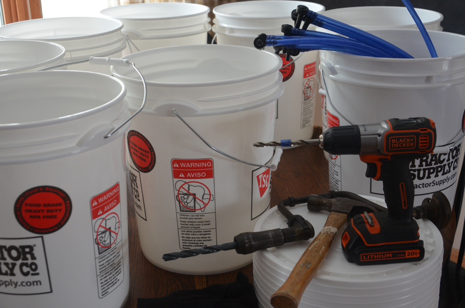 Preparing buckets and equipment for maple syrup season.