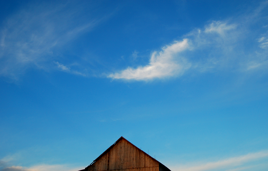 Barn roof and blue sky